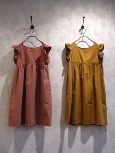 Shoulder frill tunic in pink or mustard. From Toolz Melbourne.
