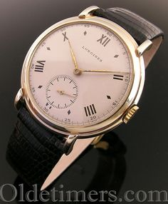 A large 9ct gold round vintage Longines watch, 1951