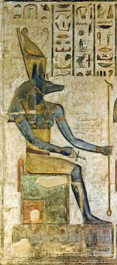 """Anubis Who is in the Place of Embalming, the Lord of the Sacred Land, Who is above His mountain, Who presides over the God's (Osiris') tent"" (translation of the hieroglyphs written above, excluding the first row at right) The God Anubis enthroned,..."