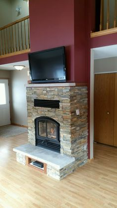 Great American Fireplace installed this Opel wood fireplace with Norstone Ochre . , Great American Fireplace installed this Opel wood fireplace with Norstone Ochre stone panels custom hearth and mantel with tv above fireplace. Wood Burning Insert, Wood Burning Fireplace Inserts, Tv Above Fireplace, Wood Fireplace, Fireplace Ideas, Stacked Stone Fireplaces, Custom Fireplace, Stone Panels, Hearth