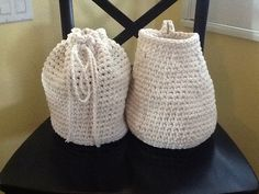 """Crochet bags. The one on the right is from a pattern by """"yes, have some"""". I changed the top on the one on the right to make it a drawstring."""