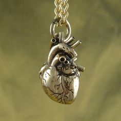 "Anatomical Heart Necklace - Bronze Anatomical Heart Pendant on 24"" Gold Plated Chain. $55.00, via Etsy."