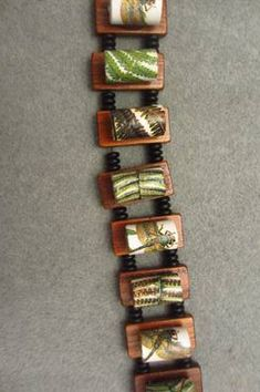 Mounted paper beads! Very clever.