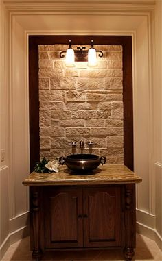 powder room - I really like the stone with the lights shining down!
