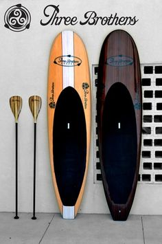 wood paddle boards by Three Brothers Boards. LOVE the dark stain!