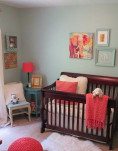 I don't like the dark furniture 0_o   But the blue and coral is good  Project Nursery - Girl Blue and Coral Nursery Crib View