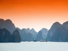 Halong Bay, located in northeast Vietnam, is beloved for its blue waters and spread of limestone islands, all occupied by tropical trees and wildlife.