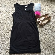 NWT! LOFT Classic LBD ⚡️Last price drop!⚡️⚡️  NWT! Never worn! Every girl needs a few LBDs...Black LOFT sleeveless dress. Has back slit which is still seen closed since never worn. Modest V neck front. Armpit to armpit stretches to 21 inches. Waistline is 17.5 left to right one side. Length from shoulder to bottom hem is 38.5.  LOFT Dresses Midi