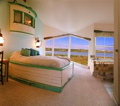 Waterfront view rooms have boats cleverly crafted into bedroom sets at Captain's Inn at Moss Landing (Moss Landing, CA)
