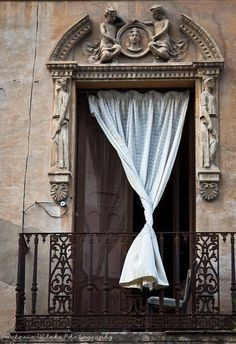 I love the way the curtain is perfectly twisted and artfully draped over the balcony in this shot. Balcony, Cordoba, Spain - photo via anne The Doors, Windows And Doors, Portal, Doorway, Architecture Details, Paris Architecture, Parisian, Tudor, Places