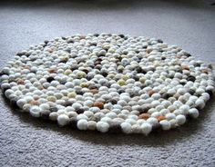 felt ball rug, I could totally make this, but I wonder how long it would take me.  Maybe I could get my kids at work to help me make the felt balls as a sequencing/following directions activity