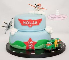 Planes - Happy Birthday Nolan :) my first Planes themed cake YaY!!!! The birthday boy requested real toys on his cake (I was hoping to make a couple fondant ones... darn it) but I really like how this came together :) TFL <3