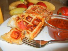 Paffles (paw-fulls) He wanted pizza.  I wanted waffles.  As a compromise with what was in the fridge we used canned biscuit, a little sauce, cheese, pepperoni or mushroom, and a waffle maker.  Make a little pouch of ingredients in the canned biscuit/dough. Spray cooking oil on waffle iron.  Toss in and cook for about 3 or so minutes.  Poof!  Paffles.  Y U M.  *NOTE:  Use cooking spray on the waffle maker just before you put the concoction in to cook.  We had paws full of paffles!