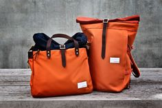 Nanamica Cycling Backpack in Orange slam jam (the other one is a briefcase)