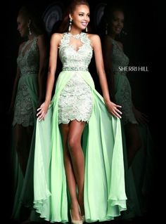 Gorgeous mint green lace high low prom dress 2014 by Sherri Hill with cut out neckline detail