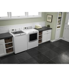 Maytag® 4.8 cu. ft. Bravos XL® HE Top Load Washer with white cabinets around it
