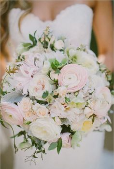 This bridal bouquet is especially perfect for spring weddings with its blush flowers. It pairs ranunculus with spray roses to a create a textured look full of gorgeous muted tones.