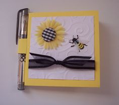 Yellow White and Black Sunflower and bee Post it note holder with gel pen. $4.00, via Etsy.