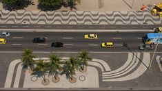 Gardens of Roberto Burle Marx  Copacabana Beach, Rio de Janeiro, Brazil  1970. An abstract design in black, white and red mosaic. The wave pattern has become iconic and is used extensively in Rio.