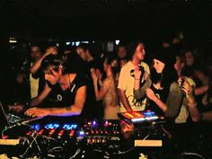 See the girl in the hat totally enthralled watching Ritchie Hawtin twist knobs & press buttons? :)
