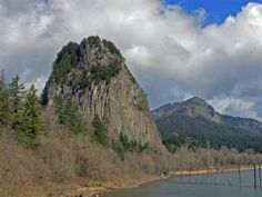 Beacon Rock Hike - Beacon Rock is one of the most prominent and distinctive geological features in the Columbia River Gorge, an 848-foot landmark that was once the core of a volcano — what remains is what was not washed away by the massive force of ice-age flooding. It is one of the tallest monoliths (singular piece of rock) in North America, along with California's El Capitan, Georgia's Stone Mountain, and Wyoming's Devils Tower