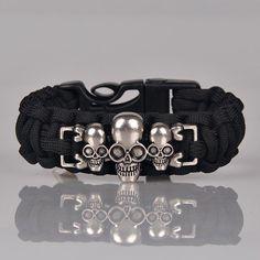 https://everythingskull.com/collections/bracelets/products/survival-paracord-bracelet-outdoor-scraper-whistle-flint-fire-starter-gear-kits-alloy-skull