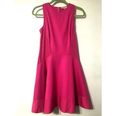 NWT Ted Baker Hot Pink Dress This Ted Baker deep pink contrast side detailed dress would be great for work, school or a day/night out. It's beautiful and in perfect condition. Can be paired with a black blazer for work/school or just add a nice pair of black heels for a night/day out. Says a size 2, but according to Ted Bakers size guide, it will fit a 6 Original price $235.00 OFFERS WELCOMED! Ted Baker Dresses Midi
