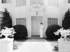 Claudette Colbert at home.