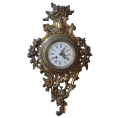 """Antique French Rococo Cartel wall clock. Stunning gilt brass. Classic Rococo asymmetrical shape with """"c"""" scrolls foliage and floral detail. The movement is made by French maker A. D. Mougin (signature on movement back plate). Excellent condition c. 1890 by themanorantiques"""