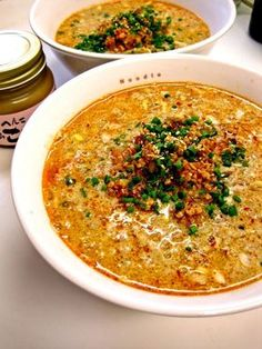 Japanese ramen recipe -  1. Cook the minced pork (100g) with sesame oil (1 tbs) until it smells good  2. Lower the heat and add chopped ginger (1 tsp) and long onion (6 inches), and pasted chili sauce (1tbs)   3. Add water (3 cups) and boil. Then add chinese soup stock (2-3 tbs), soy sauce (2 tbs), vinegar (1 ½ tbs), sugar (½ tsp)  4. Put  sesame paste into the ball and add #4 and mix. Then put it back to the pod to heat.  5. Boil noodle (I used the instant ramen noodle)  6. serve!