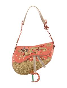 Limited Edition. Coral satin Christian Dior China Embroidered Saddle Bag with metallic orange coated hardware, metallic gold leather trim, single flat shoulder strap with dragon and logo accents, single exterior wall pocket at back, gold dragon embroidered at front, gold-tone Diorissimo lining, single interior zip pocket and velcro closure at front flap. From the 2007 Countries Collection. Shop authentic bags by Christian Dior at The RealReal.
