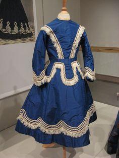 2012-08-25 KSMF -  Child's dress of blue taffeta and white fringe, circa 1860.