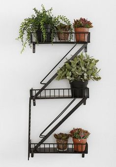 Guri, remember this? What do you think about it for the feature wall? Maybe I need to see it in person.   Fire Escape Shelf http://www.uncommongoods.com/product/fire-escape-shelf