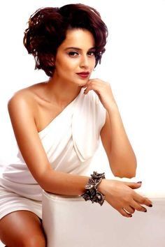 "Kangana Ranaut is acting in a latest flick 'Queen' and claims that the film has got nothing to do with Hollywood diva Marilyn Monroe or the show business.     Kangana said, ""'Queen' is the story of a very naive girl who lives in the Delhi suburbs and goes on her honeymoon alone. To know why, you'll have to watch the film."""