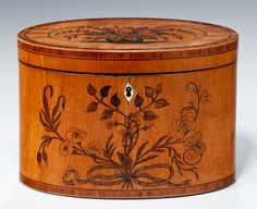 Oval satinwood tea caddy, circa 1790.
