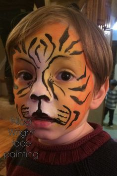 Tiger Face painting by Nicci wright