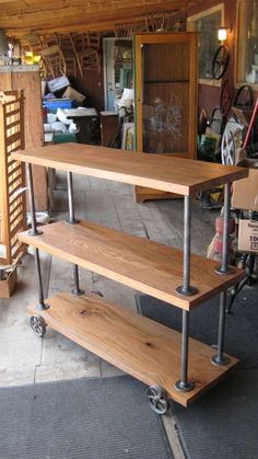 freestanding - oak wood salvaged from an old barn with steel rods and caster wheels from an old grain scale Industrial Bookshelf, Industrial Design Furniture, Pipe Furniture, Furniture Projects, Home Projects, Furniture Vintage, Industrial Storage, Reclaimed Furniture, Furniture Movers