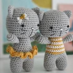 Small boy and girl cat. Log in for free on amigurumipatterns.net.