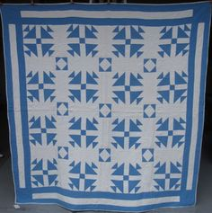 Churn Dash Quilt at www.antiquequilts.com/catalog16.htm#17720