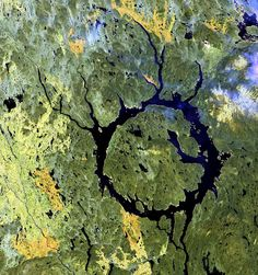 Manicouagan Impact Structure in Quebec, Canada. Lake Manicouagan and Lake Mushalagan surround the central uplift of the crater. The original diameter of the crater was 62 miles (100 kilometers), and the age has been dated at 214 million years. Shattercones (striated features found in rocks deformed by the passage of shock waves), along with shattered and brecciated rocks found in the central uplift, confirm the crater's impact origin. Several glacial advances have scoured the crater to its…