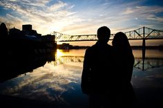 Downtown Louisville engagement picture with sunset