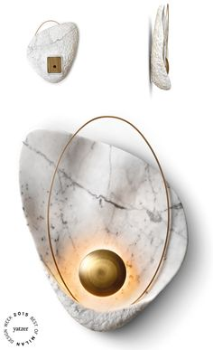 Pearl wall lamp by Ginger & Jagger. / Body: Carrara. Metal Details: Brass in Brushed Plain finishing.