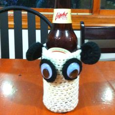 Crocheted panda bottle coozy made for a charity auction.