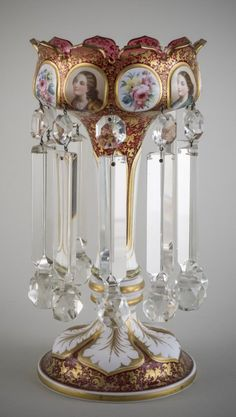 Victorian cranberry glass luster with panels decorated with flowers and personnages, gilt highlights and clear  glass prisms