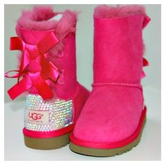 Kids Bailey Bow Uggs with Swarovski crystals ($320) ❤ liked on Polyvore featuring boots and shoes