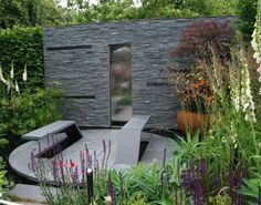 concept garden. water, cantilever benches, charcoal slate background