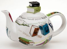 "Booklover's Personal Teapot --- A book, a comfortable chair, a free hour or two, and your own pot of tea. Bliss. From British designer Paul Cardew, porcelain pot is embellished with books, titles, and the names of famous authors: Shakespeare, Orwell, Dickens, Mark Twain, Lewis Carroll. The knob on the lid is a small stack of books. 6"" high; holds 18 oz. Dishwasher and microwave safe."
