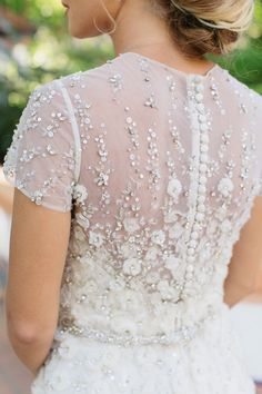 Beaded sheer short sleeve wedding dress: http://www.stylemepretty.com/2016/02/23/trend-short-sleeve-wedding-dresses/