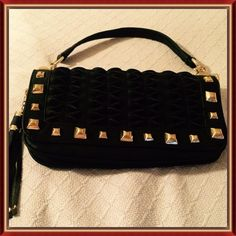 Leather Purse/Clutch/CrossBody Genuine leather fold over flap purse that can be used as a clutch or CrossBody!  Two zippered compartments.  Gold tone BIACCI nameplate on the back! Zippered outside pocket.  Gathered leather styled flap. Gold tone studs!  Leather and gold tone links and leather handle with a nine inch drop.  Fringe adornment!  Magnetic button closure on flap! Leather Crossbody strap measures 40 inches.  NWT Never Been Carried. Stored in plastic bag it came in. PAYPAL TRADES…