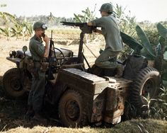 LT James Howe, Plt Ldr, D Troop, 1st Squad, 9th Cav, 1st Cav Div (Airmobile), relays orders to his security elements from the radio on his machine gun Jeep.